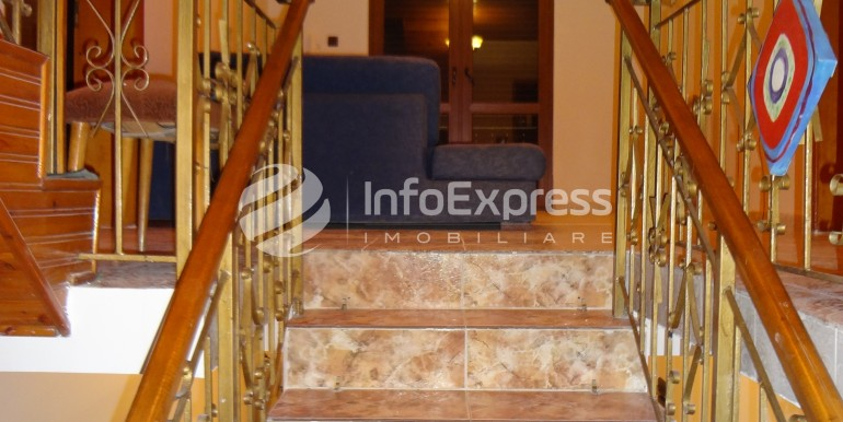 10 - stairs leading to 2nd floor (lights on)